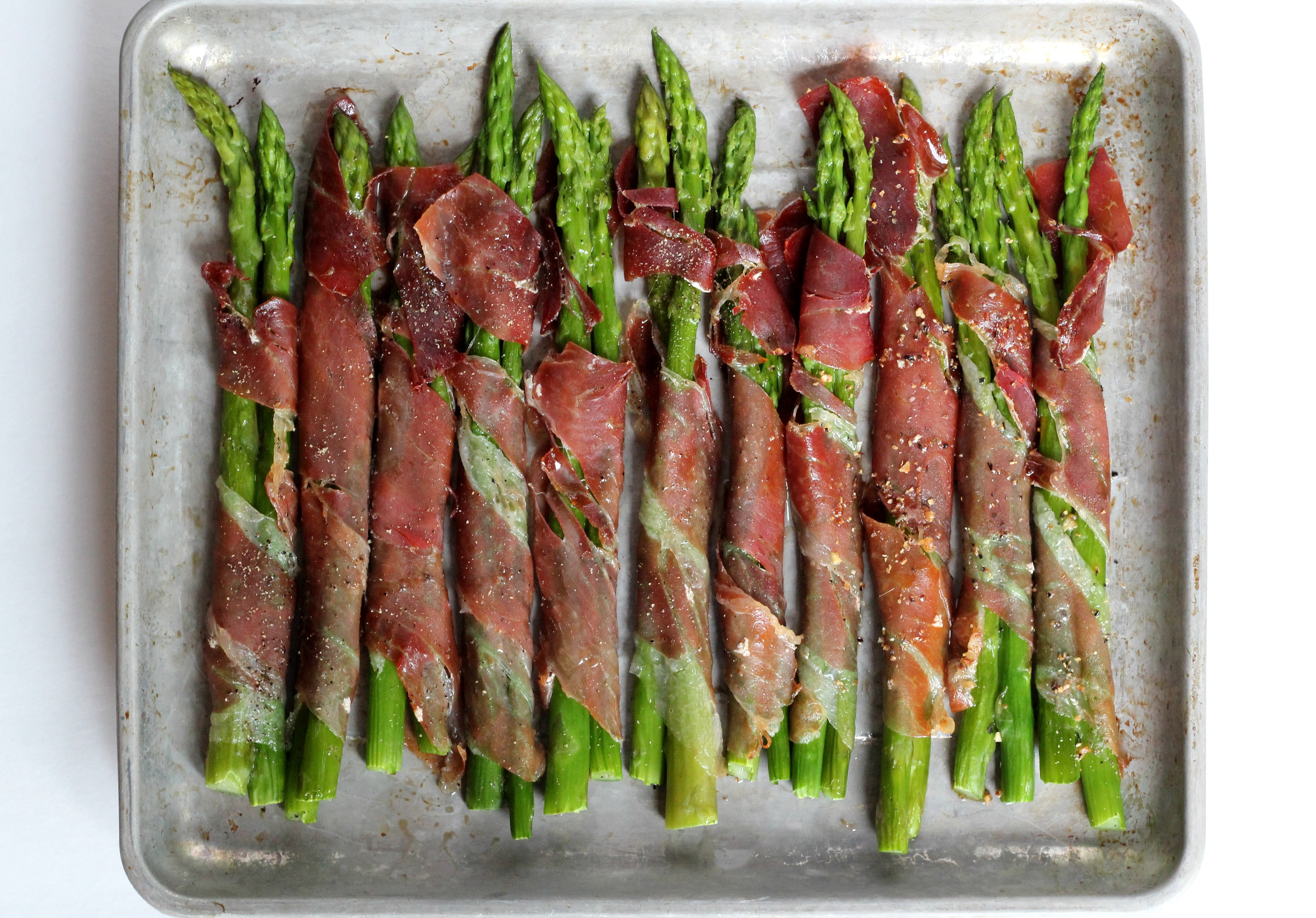 Paleo Prosciutto Wrapped Asparagus are easy to make and an impressive addition to any dinner!