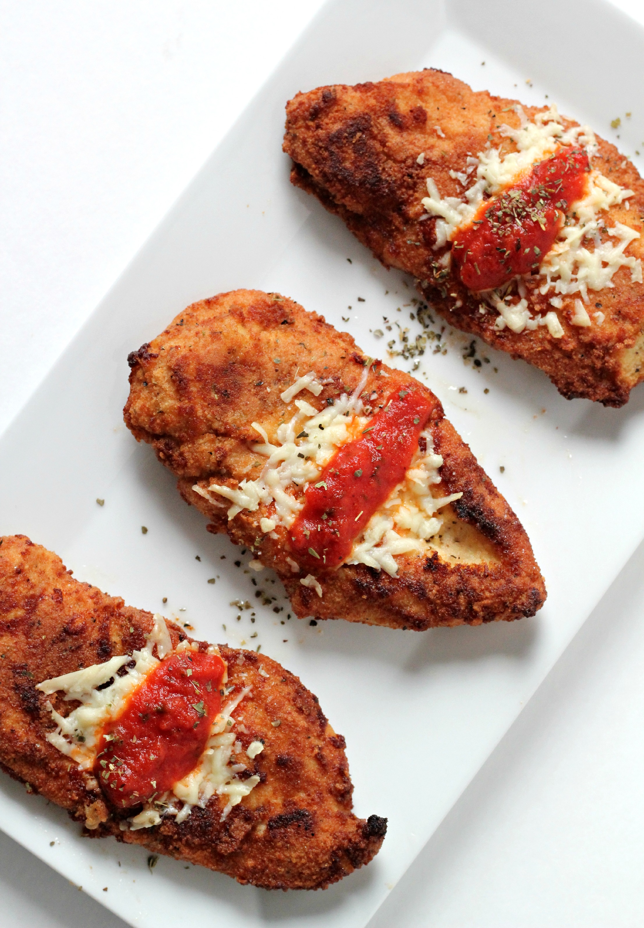 This is the best Grain Free Chicken Parmesan recipe! Make it for guests and they won't even know it's Paleo!