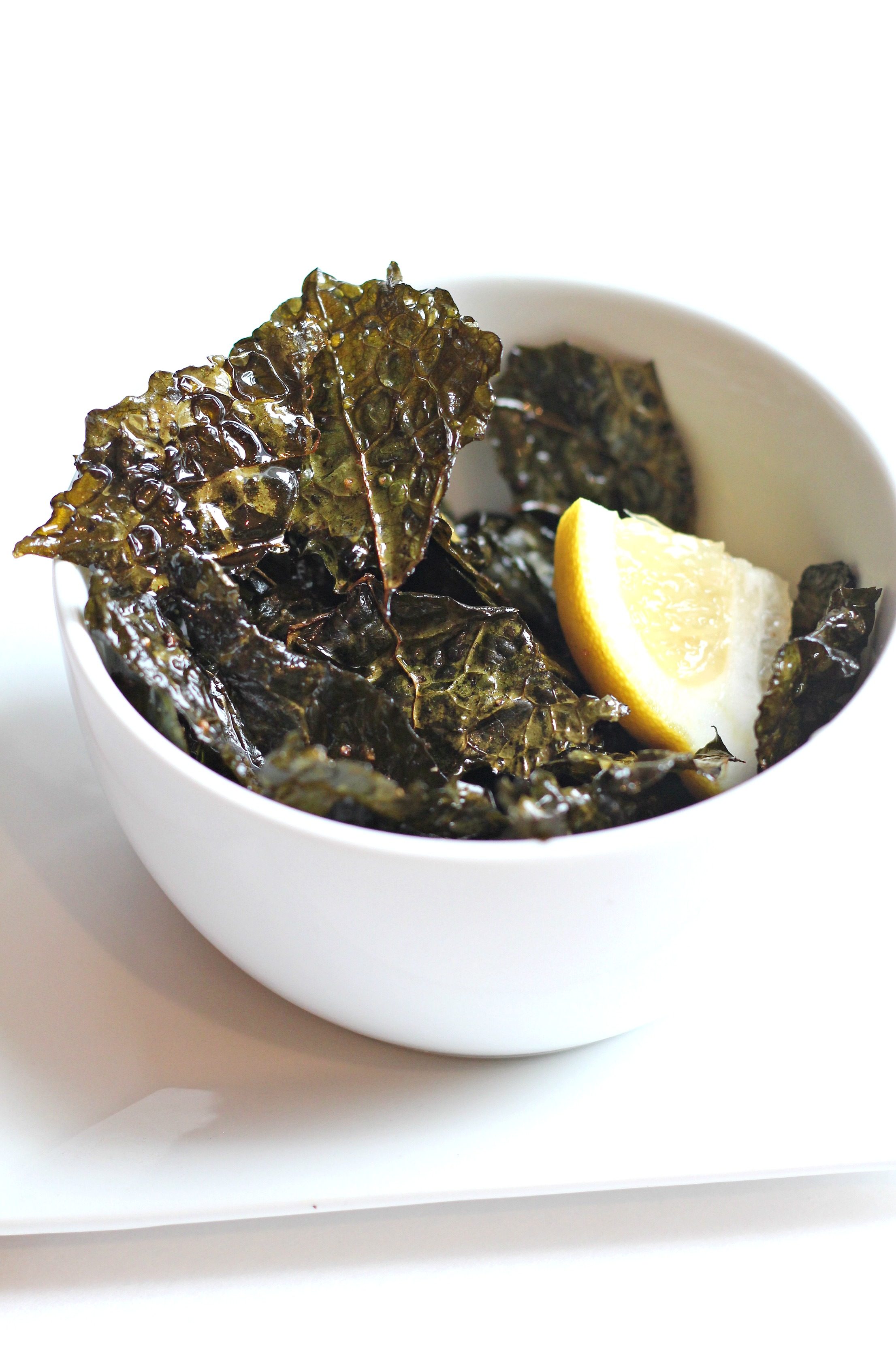 These Salt and Vinegar Kale Chips are the perfect afternoon snack! They have flavors like your favorite potato chips but the benefits of a superfood.