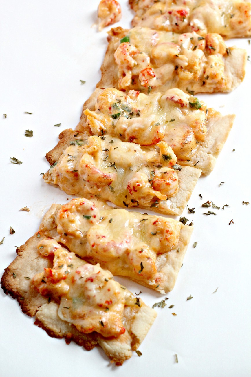 This Crawfish Bread recipe is incredibly delicious and a lighter version of your favorite New Orleans Appetizer. The crust is grain free and gluten free but the topping is decadent and creamy.