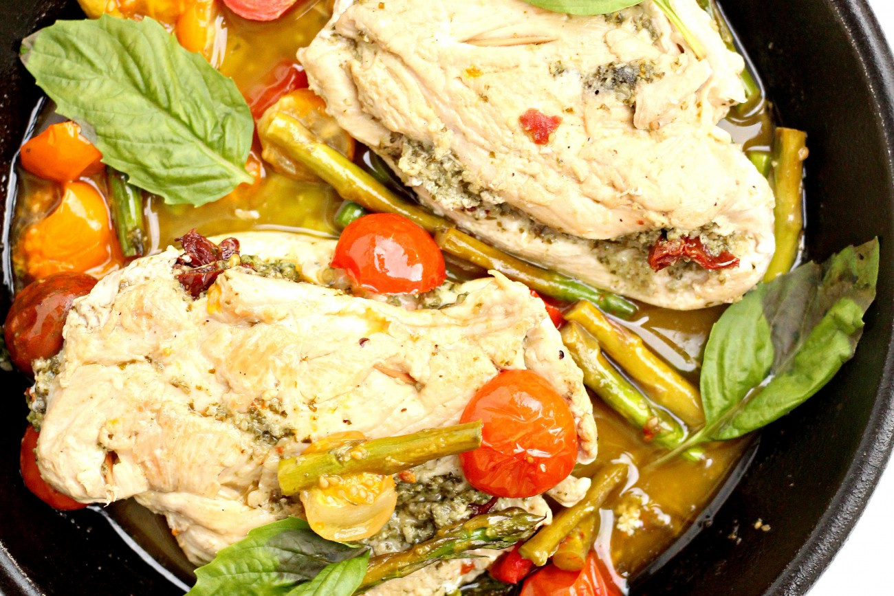 This Whole 30 Pesto Chicken with sun dried tomatoes is a one skillet meal with tons of flavors. It is gluten free, paleo, and whole30 approved.